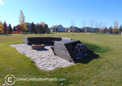 custom built campfire seating area by clarke construction projects