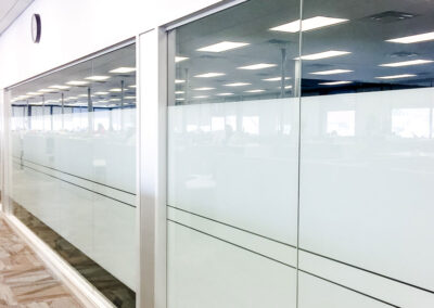 Glass wall installation by clarke construction projects