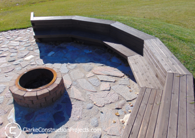outdoor bench with fire pit built by clarke construction projects