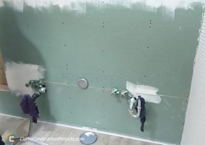 installing drywall for bathroom renovation